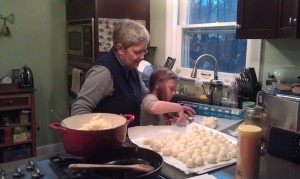 Grammas let granddaughters help make perogies.